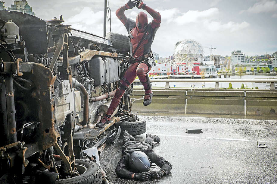 Deadpool pounces on an adversary. Photo: Joe Lederer — Twentieth Century Fox   / TM & © 2015 Marvel & Subs. TM and © 2015 Twentieth Century Fox Film Corporation. All rights reserved. Not for sale or duplication.