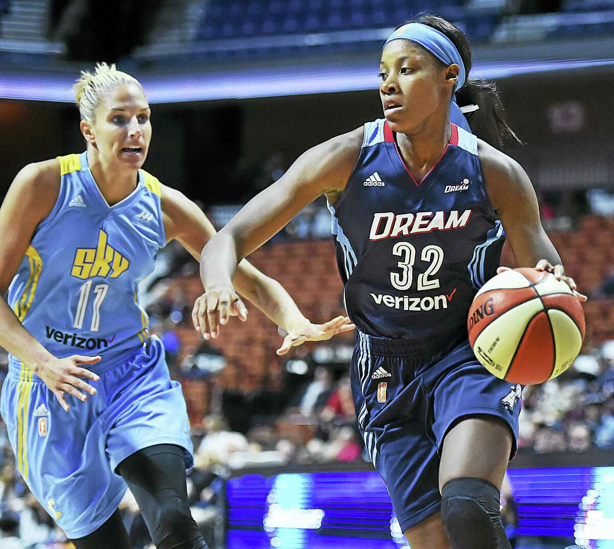 Three weeks ago, New Haven native Bria Holmes (32) was a senior in college. Thursday she was driving to the basket against the reigning WNBA Player of the Year, Elena Delle Donne of the Chicago Sky at the Mohegan Sun Arena.