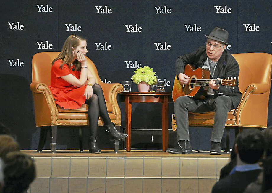 Paul Simon plays the guitar at Yale University Tuesday while his niece, Emma, looks on. Photo: Michael Marsland — Yale University