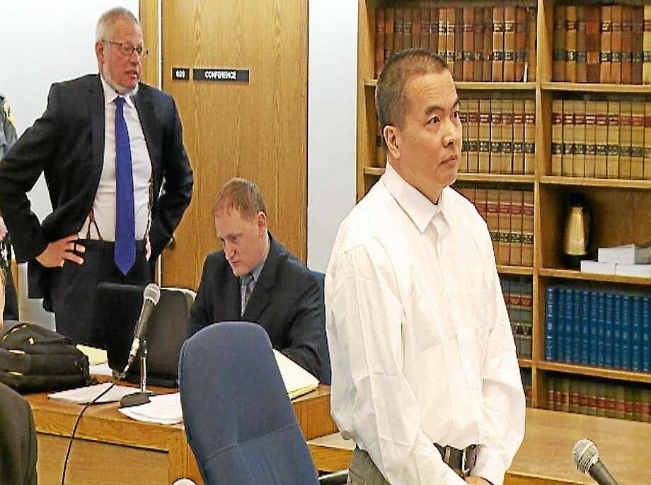 Dr. Lishan Wang, at front, during a pre-trial hearing at Superior Court in New Haven. Chief Public Defender Thomas Ullmann, stands at rear. (Pool photo/WTNH) Photo: Journal Register Co.