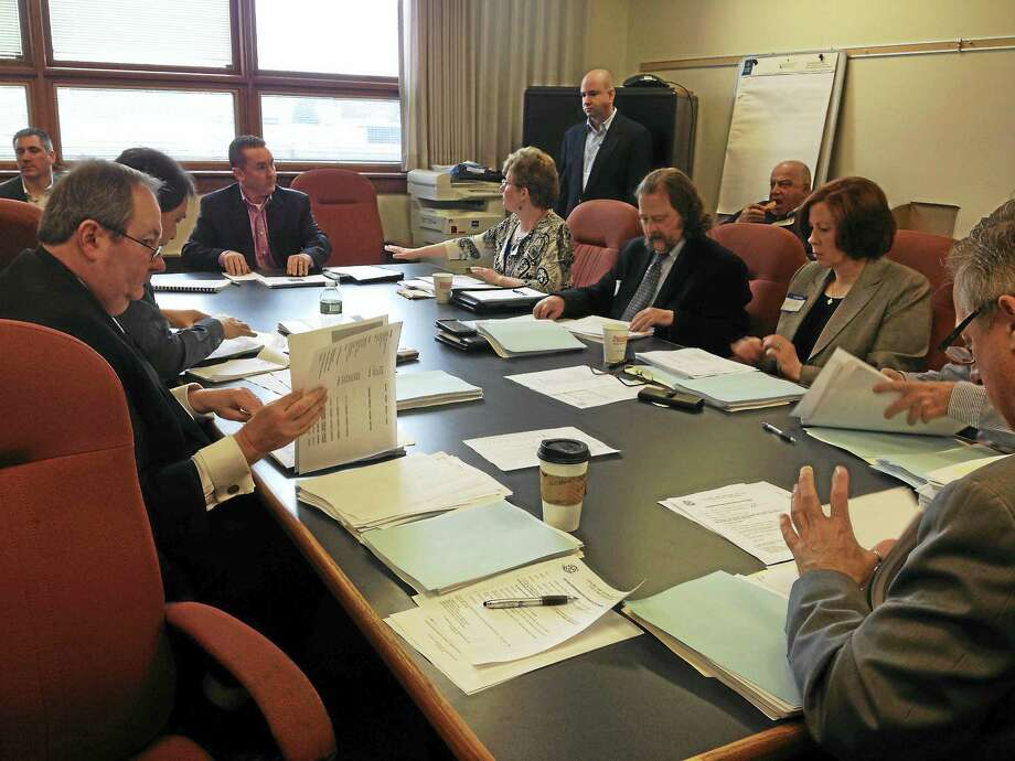 West Haven Director of Finance Kevin McNabola, far end of the table, addresses the state Municipal Finance Commission Thursday morning. Photo: Mark Zaretsky — New Haven Register