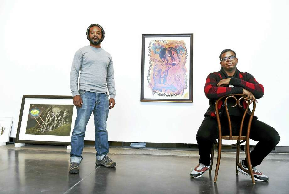 "Co-curators William Villalongo, left, and Mark Thomas Gibson during the hanging of a new exhibition ""Black Pulp!"" Wednesday January 13, 2016 at the Yale School of Art's 32 Edgewood Gallery in New Haven that explores the creative use of printed media and artwork to challenge racist narratives and change limited notions of  the black experience in America. ""Black Pulp!"" features 65 objects, including rare magazines, literary novels, cartoons, and comics, as well as contemporary art from the Black Diaspora. It tells a story of black and non-black artists and publishers working together over 90 years to draw attention to the black experience. Photo: PETER HVIZDAK - NEW HAVEN REGISTER   / ©2016 Peter Hvizdak"