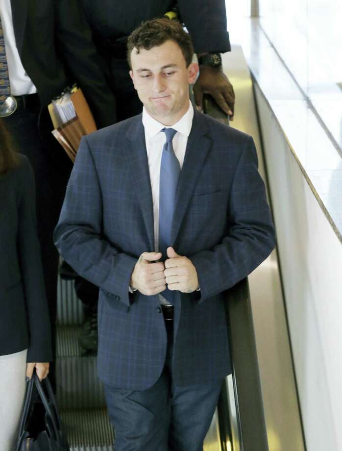 Former Cleveland Browns quarterback Johnny Manziel takes an escalator after making his initial court appearance, Thursday, May 5, 2016, in Dallas. The Heisman Trophy winner and former Texas A&M star was indicted by a grand jury last month after his ex-girlfriend alleged he hit her and threatened to kill her during a night out in January. Photo: AP Photo/LM Otero    / Copyright 2016 The Associated Press. All rights reserved. This material may not be published, broadcast, rewritten or redistribu