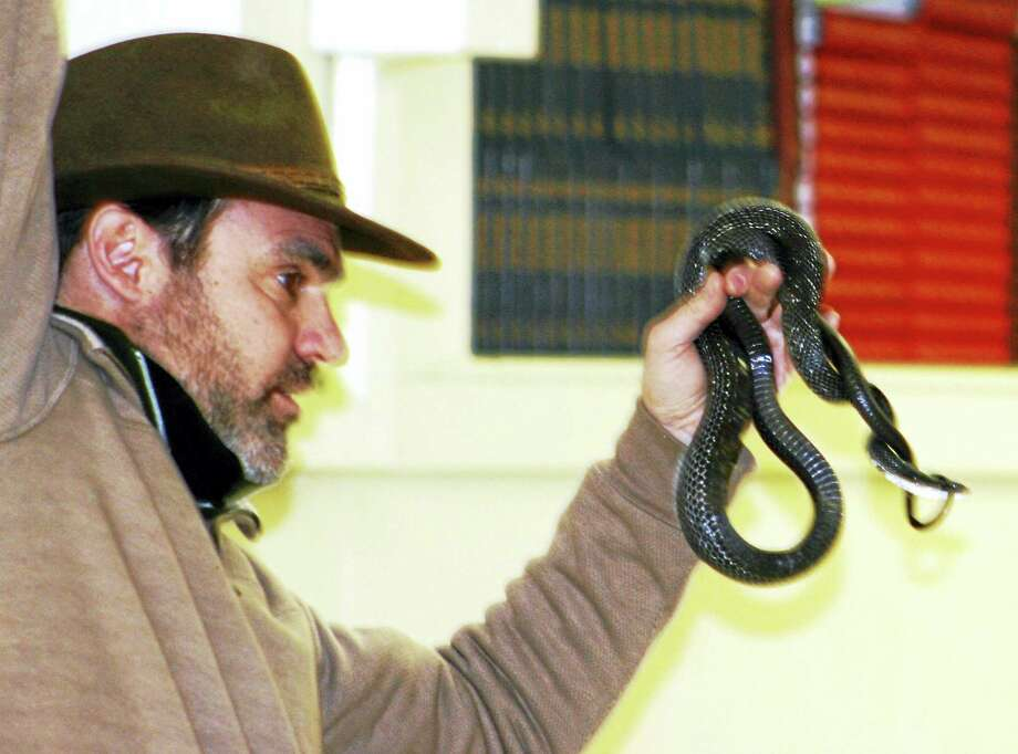 Russ Miller with a snake at a previous demonstration. Photo: Photo Courtesy Of Friends Of Hammonasset