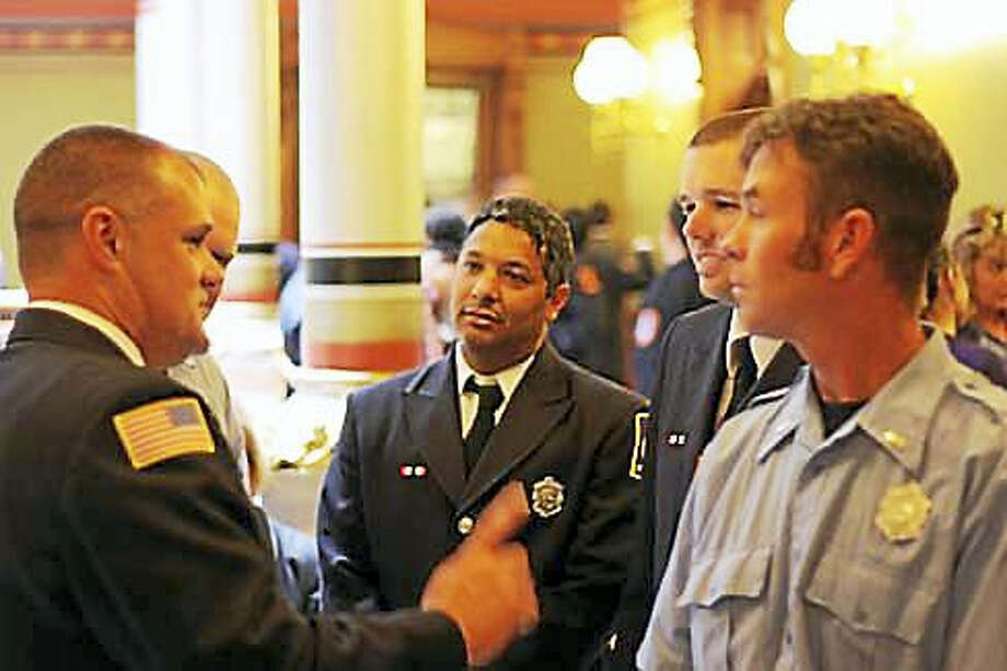 Firefighters gather at the state Capitol. Photo: Elizabeth Regan File Photo Via CTNJ