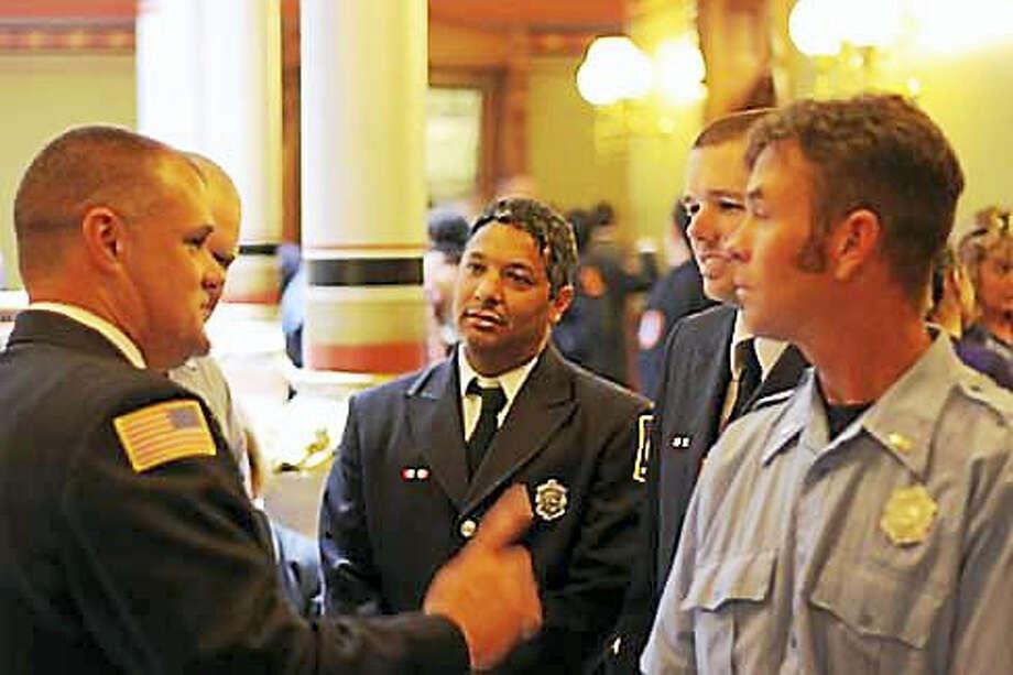 Firefighters gather at the state Capitol. Photo: Elizabeth Regan File Photo Via CTNJ