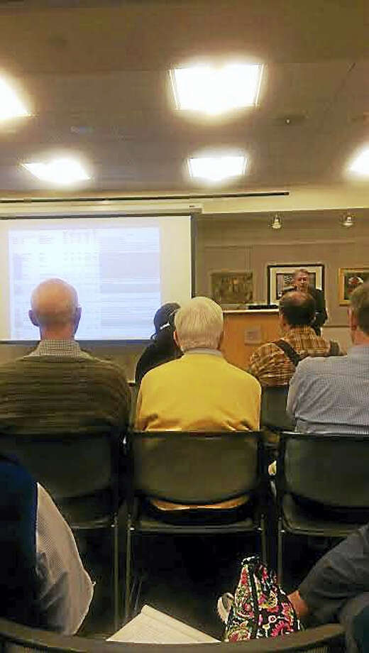 Town planner George Kral explains the affordable housing plan at the Guilford Free Library Thursday, March 10, 2016. Photo: Henry Chisholm— New Haven Register