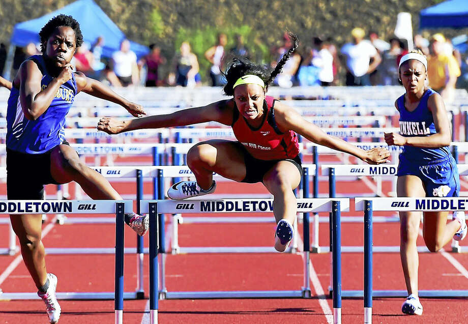 Gabbie Curtis of Wilbur Cross High School, center, runs toward the finish line as she wins the CIAC Class L Championship heat in the 100-meter hurdles Tuesday at Middletown High School. Photo: Photo By Peter Hvizdak — The New Haven Register   / ?2016 Peter Hvizdak