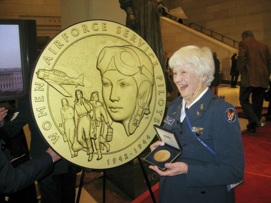 This photo provided by the Harmon family shows Elaine Harmon at the Congressional Gold Medal ceremony on Capitol Hill in Washington in 2010. The ashes of World War II veteran Harmon are sitting in a closet in her daughter's home, where they will remain until they can go where her family says is her rightful resting place: Arlington National Cemetery. Harmon was a pilot in World War II under a special program, Women Airforce Service Pilots, that flew noncombat missions to free up male pilots for combat. Photo: Bill Harmon Via AP   / Harmon Family