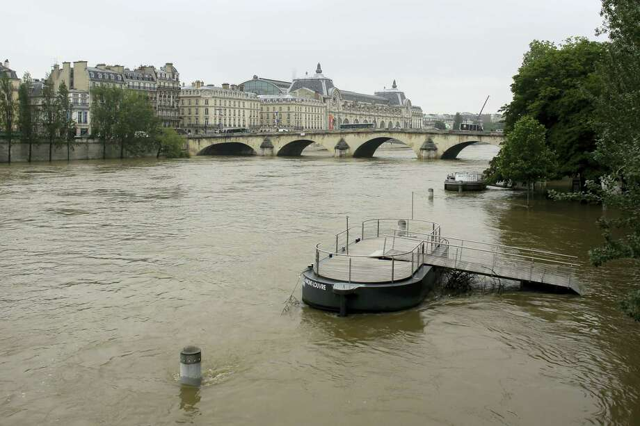 A pier is partially submerged by the river Seine in Paris, Wednesday, June 1, 2016. Paris City Hall closed roads along the shore of the Seine from the southwest edge of the city to the neighborhood around the Eiffel Tower as the water level has risen 4.3 meters (14 feet 1 inches) higher than usual. Photo: AP Photo/Markus Schreiber    / Copyright 2016 The Associated Press. All rights reserved. This material may not be published, broadcast, rewritten or redistribu