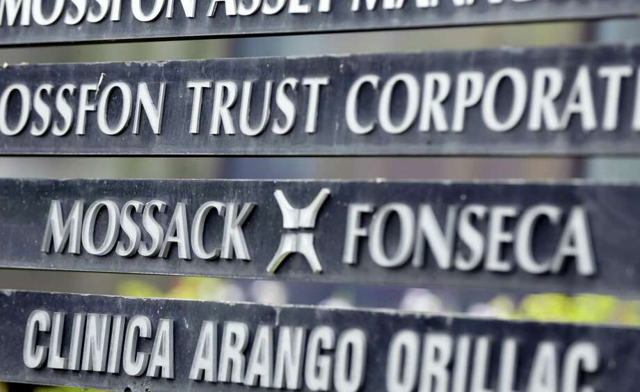 In this April 4, 2016 photo, a marquee on a building in Panama City, Panama, lists the Mossack Fonseca law firm, one of the leaders in setting up offshore bank accounts for the rich and powerful. Offshore accounts conjure up images of malicious misdeeds, but many people use them for more than just hiding bribes and laundering money. And offshore accounts can be a financial tool for more than just the ultra-wealthy, too. Photo: AP Photo/Arnulfo Franco, File   / AP