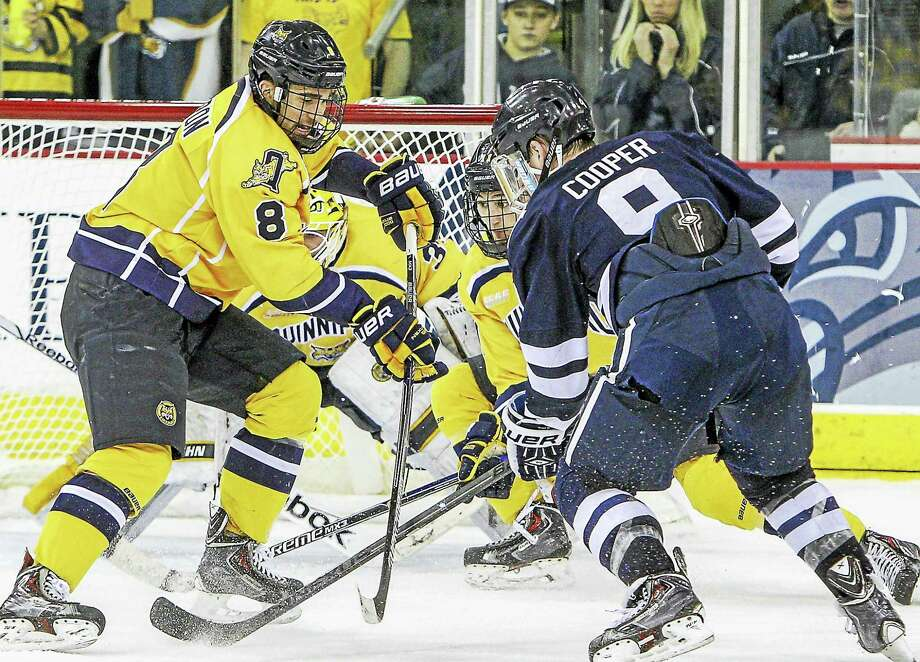 Alex Miner-Barron (8) was convinced his collegiate hockey career was over until a call from head coach Rand Pecknold led him back to Quinnipiac and now a trip to the Frozen Four. Photo: John Vanacore — For The Register   / COPYRIGHTED