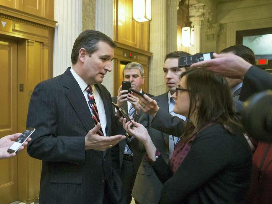 ASSOCIATED PRESS  In this Feb. 10 photo, Republican presidential candidate Sen. Ted Cruz, R-Texas, talks to reporters outside the Senate chamber on Capitol Hill in Washington. Photo: AP / AP