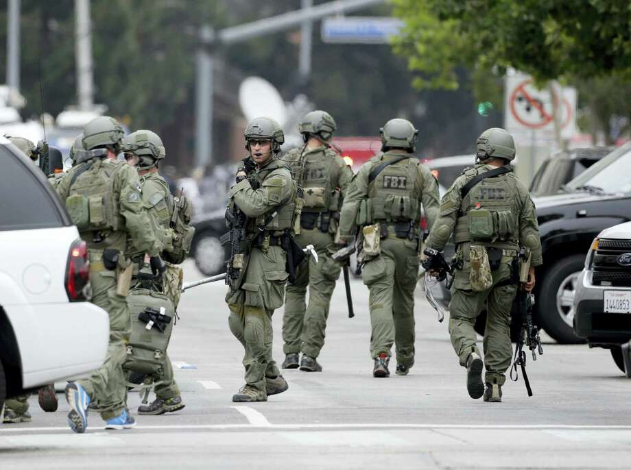 An FBI SWAT team arrives at the scene of a fatal shooting at the University of California, Los Angeles, Wednesday, June 1, 2016, in Los Angeles. Photo: AP Photo — Nick Ut    / Copyright 2016 The Associated Press. All rights reserved. This material may not be published, broadcast, rewritten or redistribu