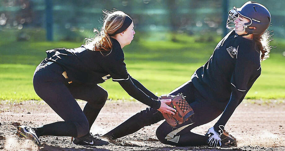 Law's Cali Jolley slaps a tag on Joel Barlow's Sabrina Lalor at second in a 9-1 loss for the Eagles, Tuesday at Jonathan Law High School in Milford. Photo: Catherine Avalone – New Haven Register   / New Haven RegisterThe Middletown Press