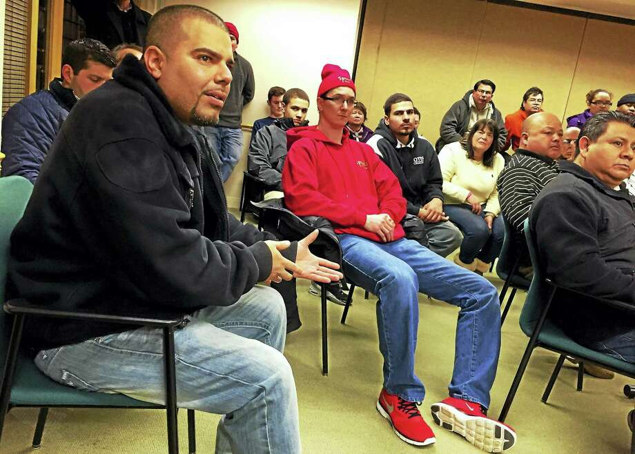Jose Nuñez, owner of La Jaltera food truck, address some of his concerns during a meeting about the city's plan to overhaul local food vending ordinances Thursday at City Hall in New Haven. Photo: Esteban L. Hernandez — New Haven Register