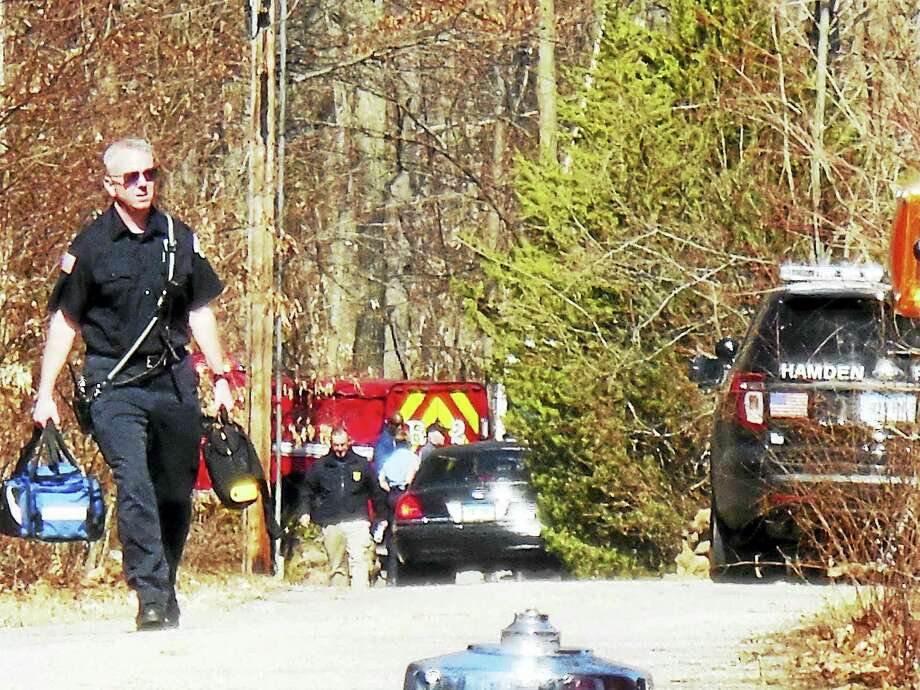 Several firefighters and police officers searched the woods of northwest Hamden late Tuesday and early Wednesday to find Kingsley Birdsall, who had gone missing. Photo: Wes Duplantier — New Haven Register