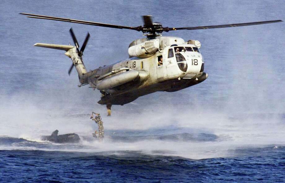In this Feb. 18, 2003, file photo, U.S. Marines and their Philippine counterparts jump from a US Marines CH-53D Sea Stallion helicopter at Ternate in Cavite province south of Manila. The U.S. Coast Guard says two Marine helicopters have collided off the Hawaiian island of Oahu. Photo: AP Photo/Bullit Marquez, File    / AP