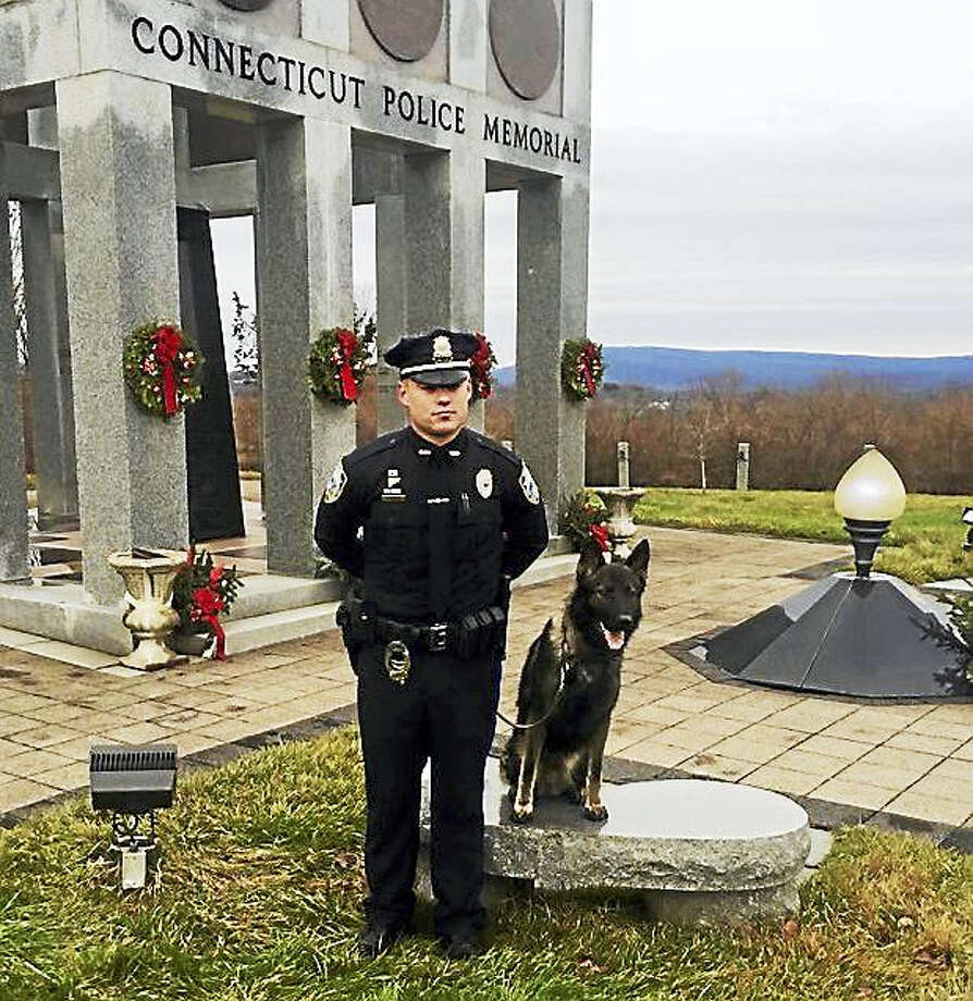Officer Justin Standish and his K-9 partner, Cody Photo: Photo Courtesy Of The West Haven Police Department