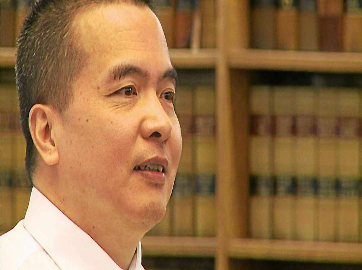 Dr. Lishan Wang during a pre-trial hearing at Superior Court in New Haven.