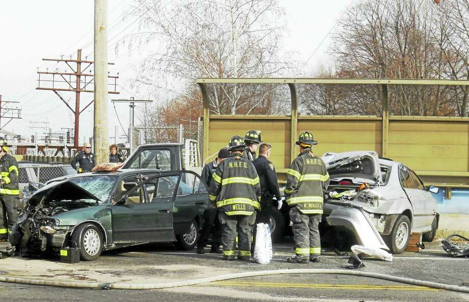 Two people were taken to the hospital after a serious crash Friday afternoon on Howard Avenue north of Kimberly Avenue. Fire crews had to extricate two people from the green car. Their conditions were not immediately available. Photo: Wes Duplantier — New Haven Register