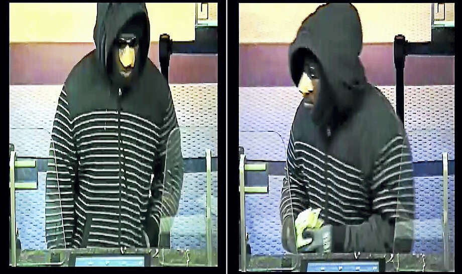 Police are looking for this man who allegedly robbed Webster Bank, 80 Elm St., Tuesday in New Haven. The man escaped with an undetermined amount of cash. Photo: Courtesy Of New Haven Police Department