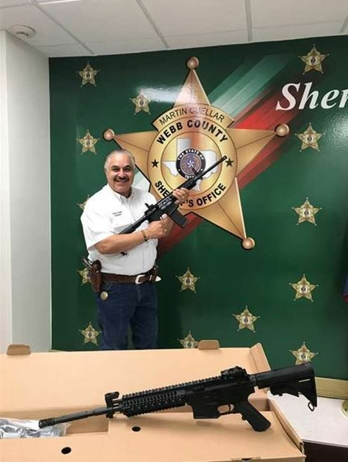 Sheriff Martin Cuellar poses with two rifles awarded by the NRA to the Webb County Sheriff's Office. Photo: Courtesy