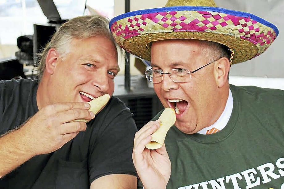 Seymour First Selectman Kurt Miller, right, wears a sombrero during the 4th annual Cinco de Mayo Elected Officials' Taco-Eating Contest Thursday at Hot Tamale's Mexican Grille and Bar. At left is Seymour Land Trust President Alex Danka, the winner of this year's contest. Photo: Jean Falbo-Sosnovich — New Haven Register