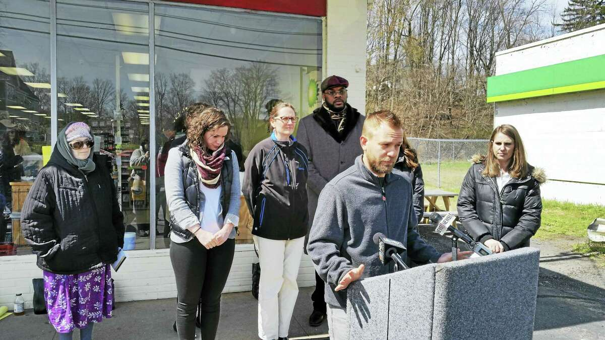Thyme and Seasons owner Josh Elliot voiced his support Wednesday at a press conference outside his Whitney Avenue store on a bill in the state legislature that would create a paid family and medical leave program.