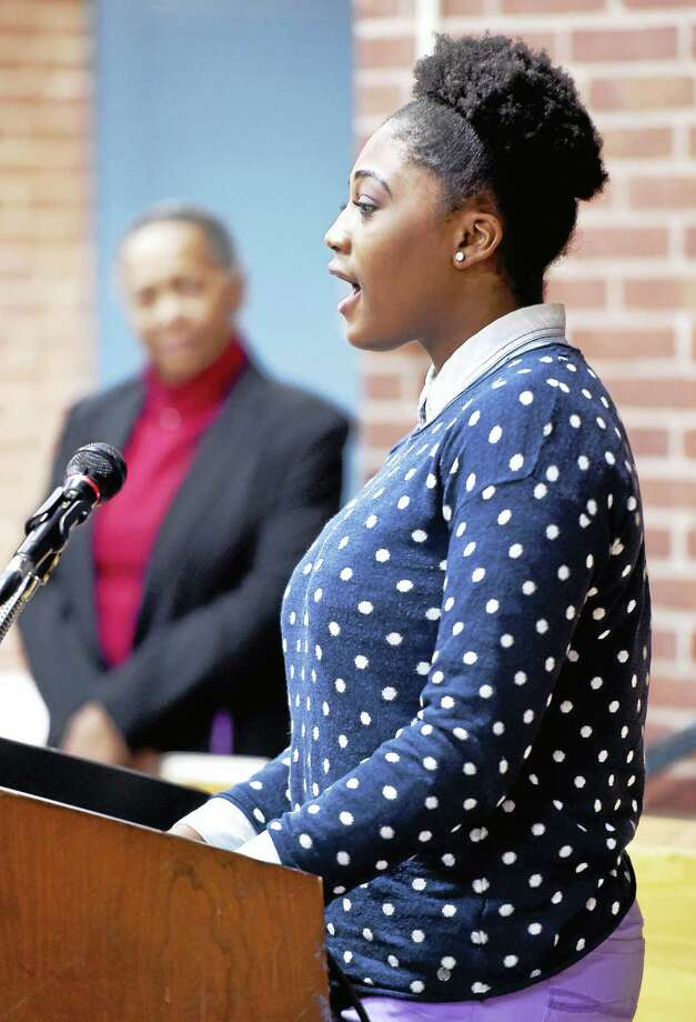 """Hamden High School senior Maya Michelle sings """"Lift Every Voice and Sing"""" at the Martin Luther King Jr. tribute at the Thornton Wilder Hall in Hamden. Photo: Arnold Gold — New Haven Register"""