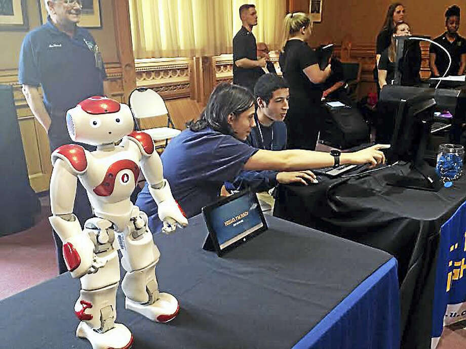 Wilcox Tech students Ben Matakaetis and Nabil Hamideh program robot Nao's movements. Photo: Brian Zahn — New Haven Register