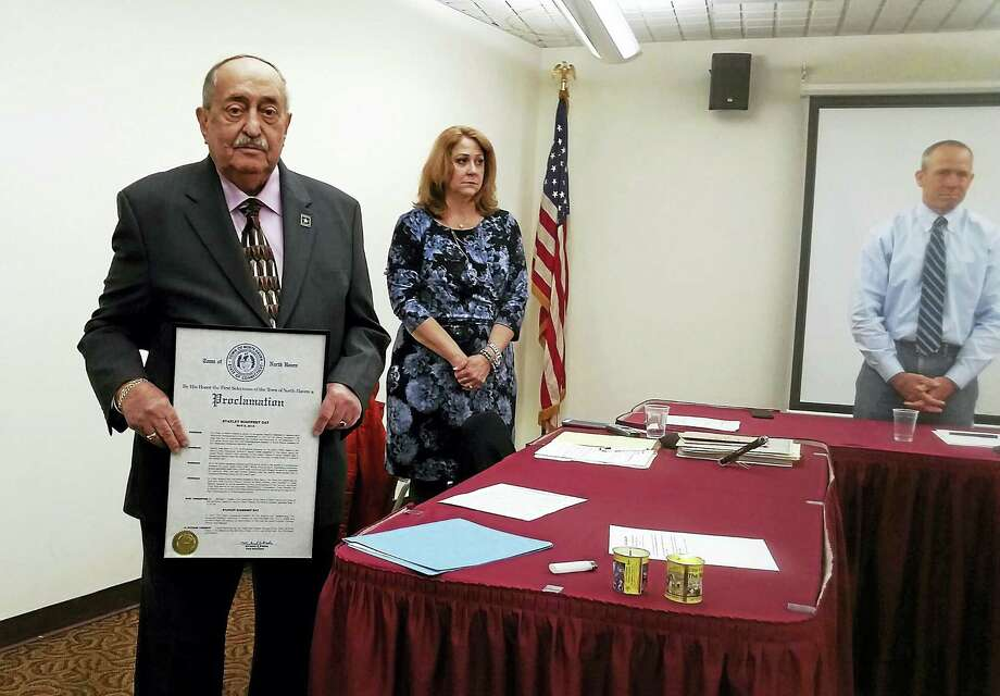 Stanley Sosensky, left, with the proclamation First Selectman Michael Freda presented to him Thursday night during the Board of Selectmen meeting. Photo: KATE RAMUNNI — NEW HAVEN REGISTER