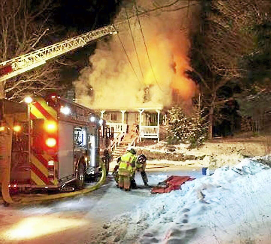 Firefighters from Oxford, Seymour, Southbury, Beacon Falls and Monroe were all called in to help Tuesday night after a fire broke out at a home on Christian Street in Oxford. One firefighter was reportedly hurt. Photo: Photos From Beacon Hose Co. #1