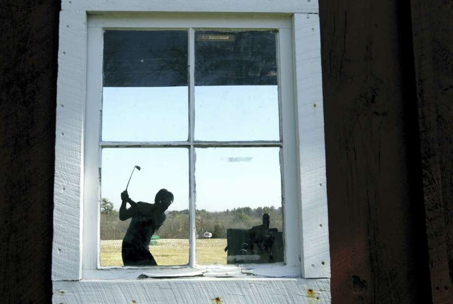 Tatsuya Goto of Cambridge, Mass. practices his swing at a golf range, Wednesday, March 9, 2016, in Middleton, Mass. Photo: AP Photo/Elise Amendola / Copyright 2016 The Associated Press. All rights reserved. This material may not be published, broadcast, rewritten or redistributed without permission.