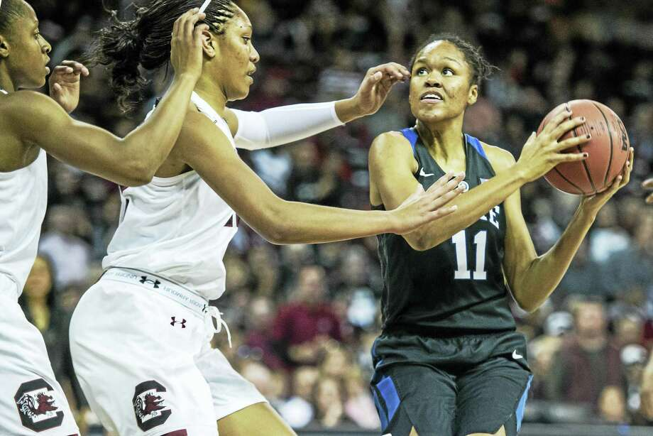 Duke forward Azura Stevens (11) drives to the hoop against South Carolina forward A'ja Wilson during the second half of an NCAA college basketball game Sunday, Dec. 6, 2015, in Columbia, S.C. South Carolina defeated Duke 66-55. (AP Photo/Sean Rayford) Photo: AP / FR171415 AP