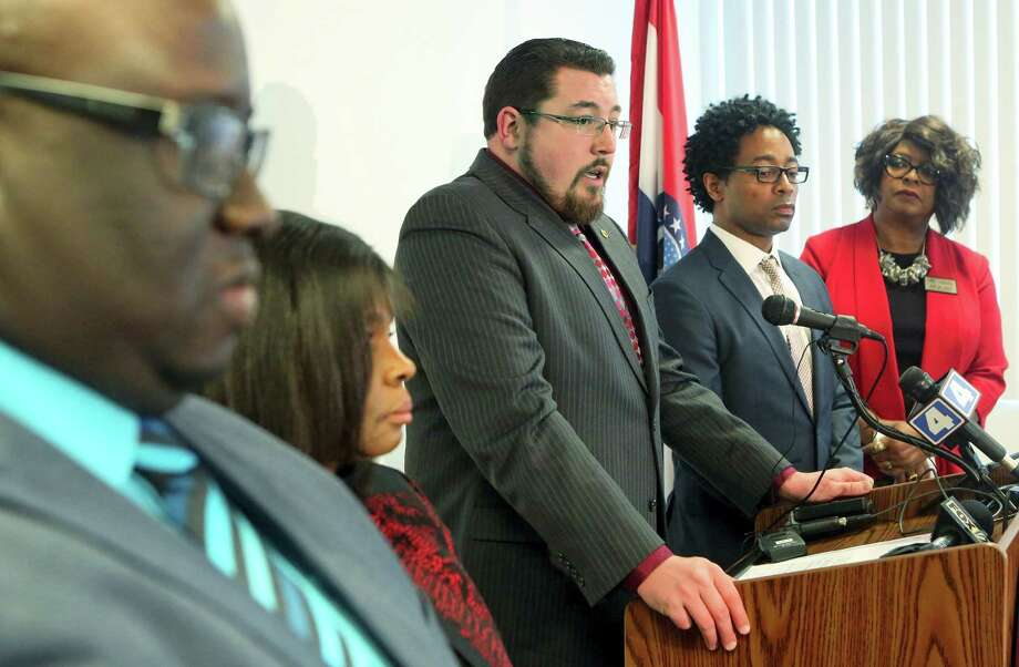 Ferguson Mayor James Knowles, center, talks at a press conference on Wednesday, Feb. 10, 2016, at the City of Ferguson Community Center, about the revisions and unanimous vote in favor of the DOJ agreement. With Mayor Knowles are from left: City Manager DeCarlon Seewood, Councilwoman Laverne Mitchom, Knowles, Councilman Wesley Bell and Councilwoman Ella M. Jones. Photo: J.B. Forbes/St. Louis Post-Dispatch Via AP   / St. Louis Post-Dispatch
