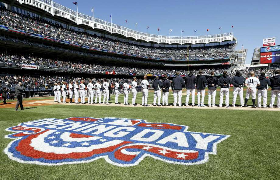 Yankees players stand on the baseline during the National Anthem on Tuesday at Yankees Stadium. Photo: Kathy Willens — The Associated Press   / Copyright 2016 The Associated Press. All rights reserved. This material may not be published, broadcast, rewritten or redistributed without permission.