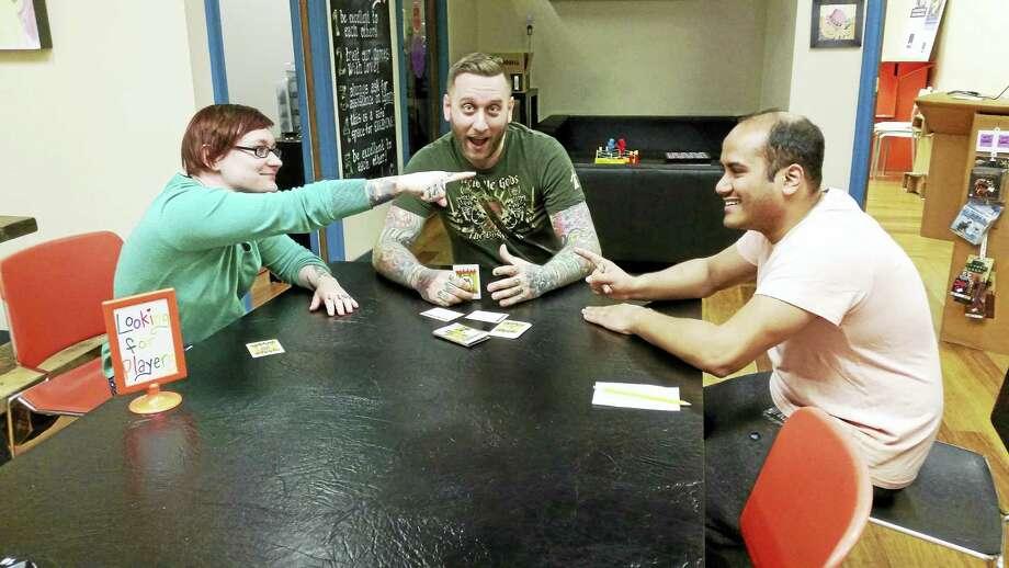 Trish Loter, Matt Loter and Vishal Patel of Happiness Lab / Elm City Games Photo: Journal Register Co.