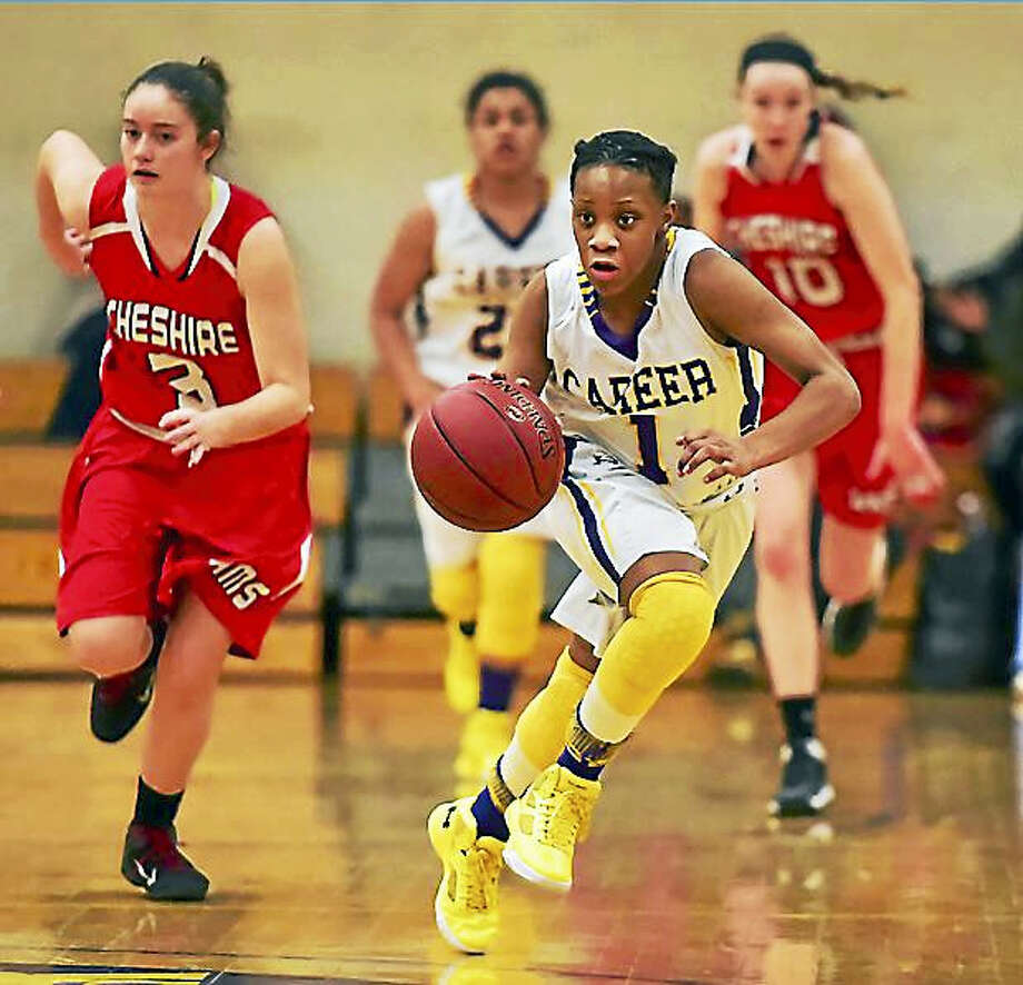 Career's Ky'Jae Hargrove drove past Sara Mulligan in a fastbreak Wednesday as the Panthers defeated the Cheshire Rams, 58-55 at the Hill Regional Career High School gymnasium. Photo: Catherine Avalone — New Haven Register