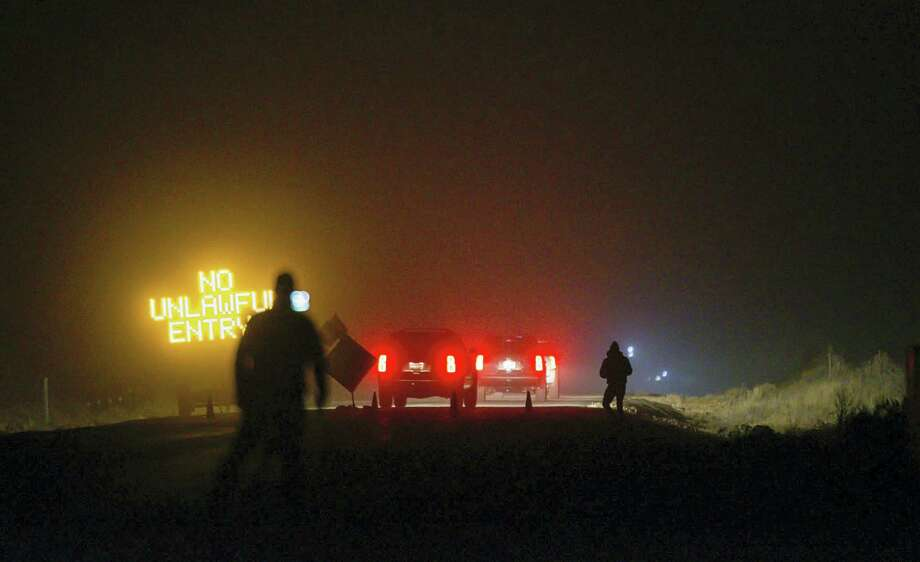 Three SUV proceeds through the Narrows roadblock near Burns, Ore., as FBI agents have surrounded the remaining four occupiers at the Malheur National Wildlife Refuge, on Wednesday, Feb.10, 2016. The four are the last remnants of an armed group that seized the Malheur National Wildlife Refuge on Jan. 2 to oppose federal land-use policies. Photo: Thomas Boyd/The Oregonian Via AP / The Oregonian