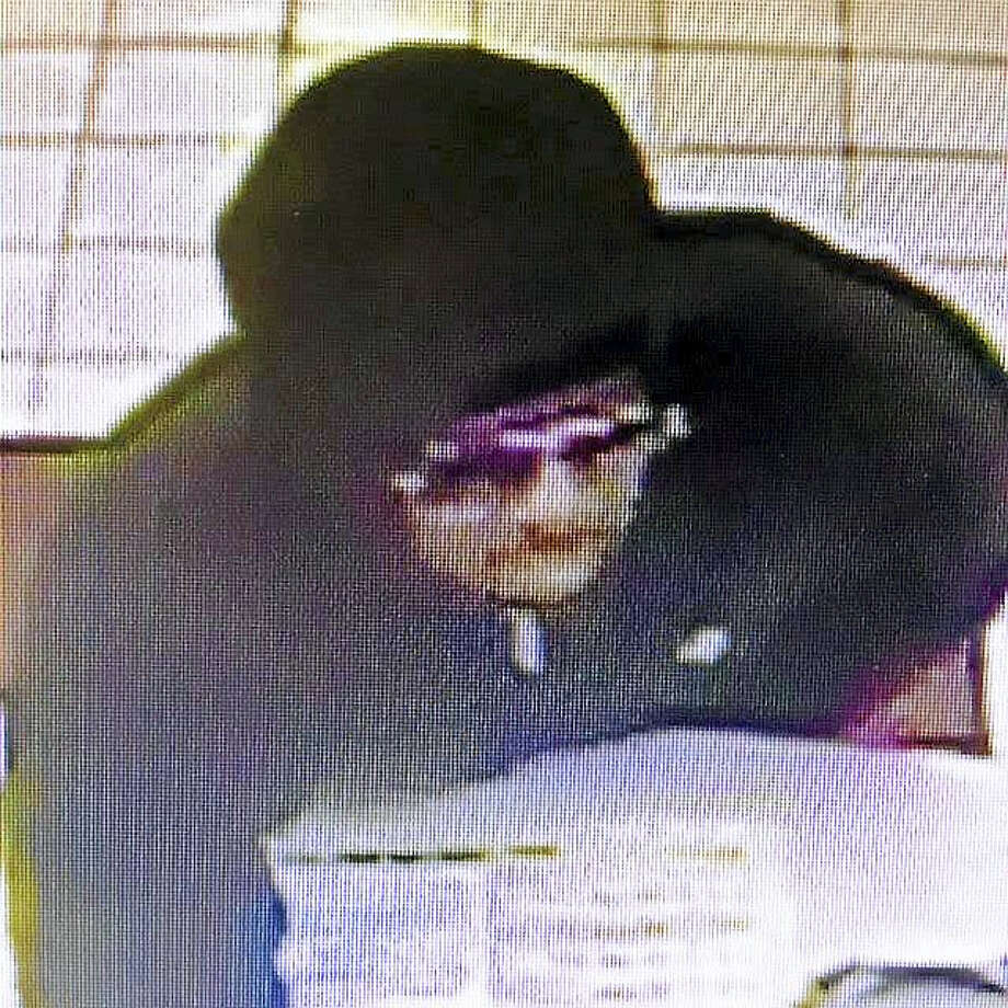 Police in East Haven are asking the public to help them find this man, who allegedly held up the Sunoco gas station on Frontage Road Sunday morning. The holdup was the second such incident there in three weeks. Photo: Courtesy Of East Haven Police Department
