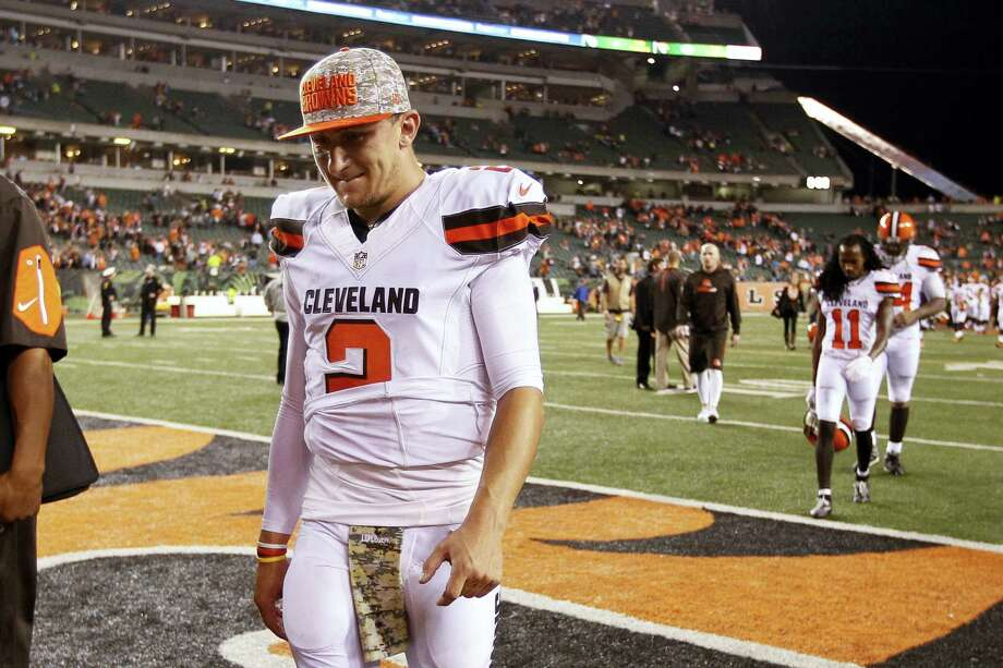 The Browns said Tuesday that Johnny Manziel was diagnosed with a concussion late in the season by an independent neurologist, countering an NFL Network report they lied about the injury to cover up the troubled quarterback showing up intoxicated for practice. Photo: The Associated Press File Photo   / FR170726 AP