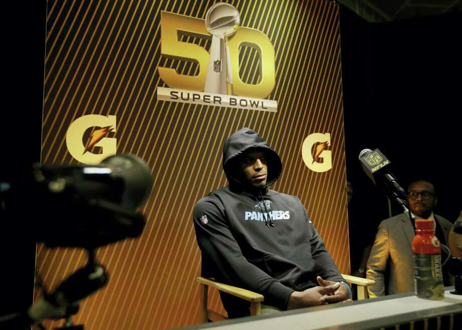 Panthers quarterback Cam Newton answers questions after the NFL Super Bowl 50. On Tuesday, Newton defended walking out of the press conference. Photo: The Associated Press File Photo   / AP