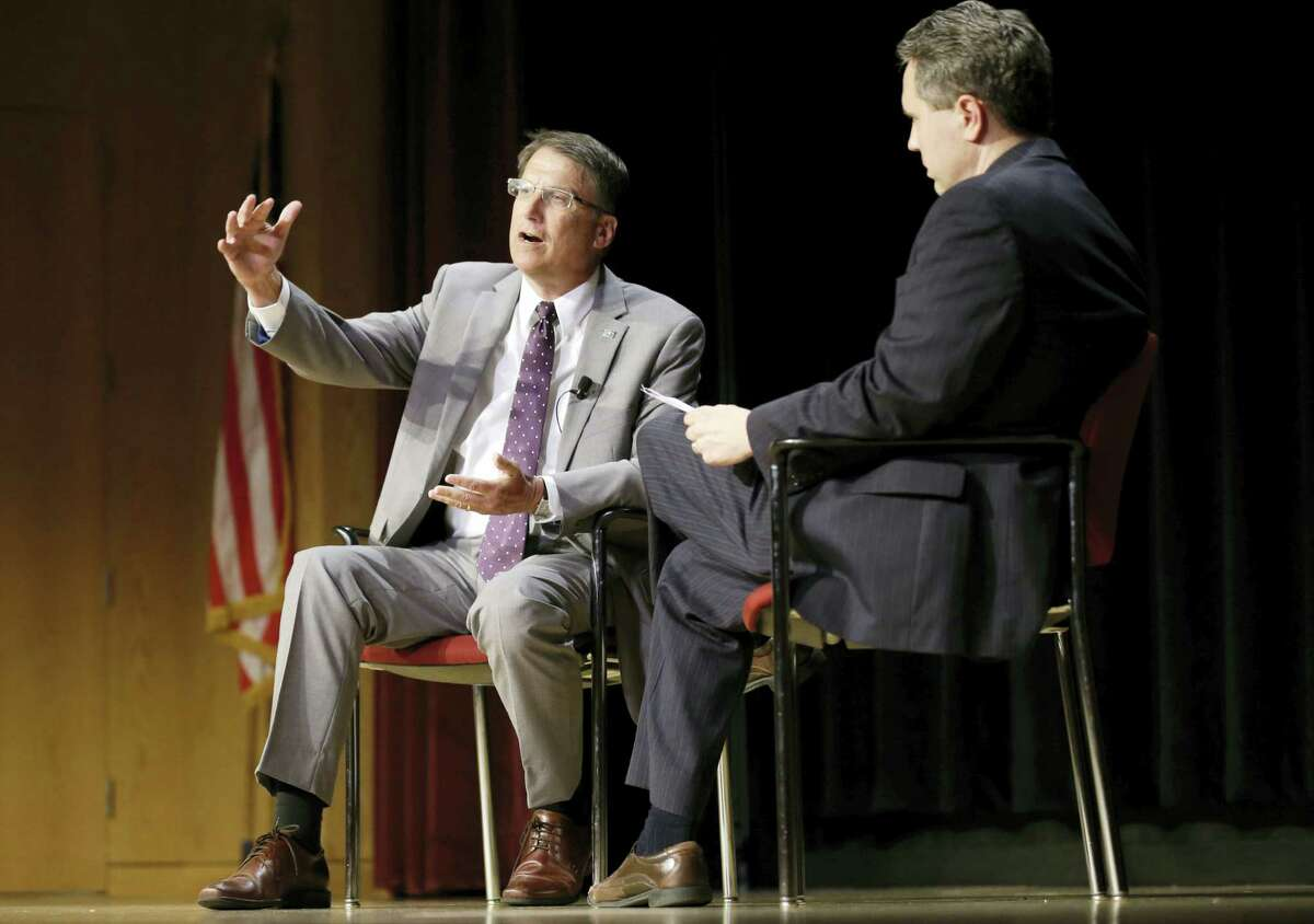 North Carolina Gov. Pat McCrory, left, makes remarks regarding House Bill 2 while speaking during a government affairs conference in Raleigh, N.C., Wednesday, May 4, 2016. A North Carolina law limiting protections to LGBT people violates federal civil rights laws and can't be enforced, the U.S. Justice Department said Wednesday, putting the state on notice that it is in danger of being sued and losing hundreds of millions of dollars in federal funding.