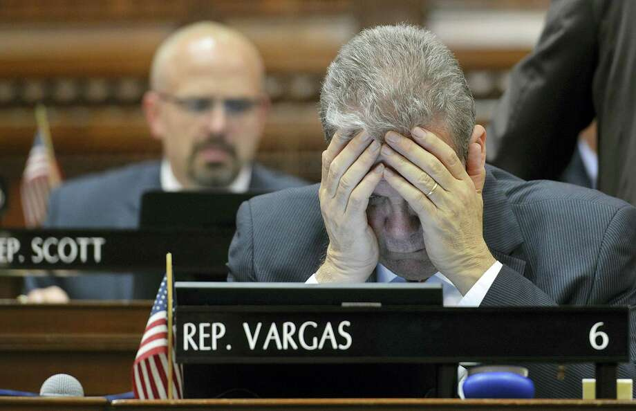 Rep. Edwin Vargas of Hartford gestures as he looks at his computer screen during the last day of the legislative session in Hartford, Wednesday, May 4, 2016. Democratic leaders scrapped plans Wednesday evening to push through an 11th-hour budget deal on the final day of the legislative session, acknowledging there was not enough time to pass the bill before a fast-approaching midnight adjournment. Photo: Peter Casolino — Hartford Courant Via AP / Hartford Courant