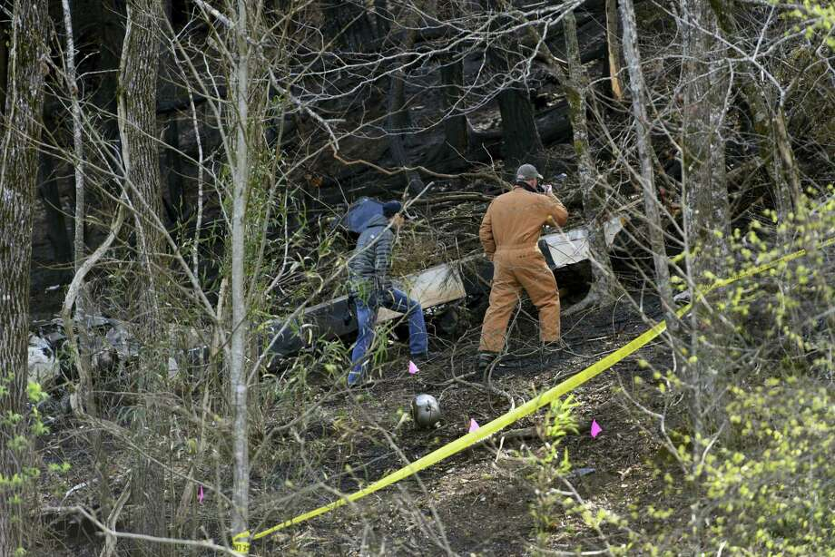 Officials investigate where a sightseeing helicopter crashed, Tuesday, April 5, 2016, near Sevierville, Tenn. Investigators were headed to the scene of the sightseeing helicopter crash that killed five people near the Great Smoky Mountains National Park in eastern Tennessee. Photo: Michael Patrick — Knoxville News Sentinel Via AP / Knoxville News Sentinel