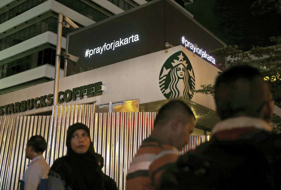 """An electronic screen above the Starbucks cafe where an attack took place displays the message """"Pray for Jakarta"""" showing support for the city in Jakarta, Indonesia, Thursday, Jan. 14, 2016. Attackers set off bombs and exchanged gunfire outside the cafe in Indonesia's capital in a brazen assault Thursday that police said """"imitated"""" the recent Paris attacks. Photo: AP Photo/Dita Alangkara / AP"""