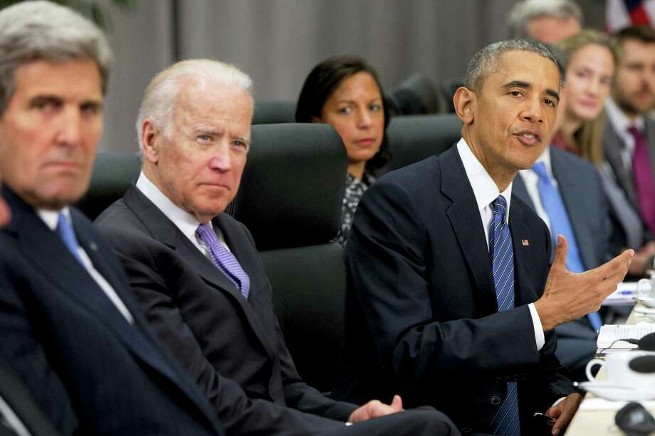 President Barack Obama, accompanied by, from left, Secretary of State John Kerry, Vice President Joe Biden and National Security Adviser Susan Rice, speaks during a meeting with Chinese President Xi Jinping at the Nuclear Security Summit in Washington March 31. Photo: Jacquelyn Martin — The Associated Press   / AP
