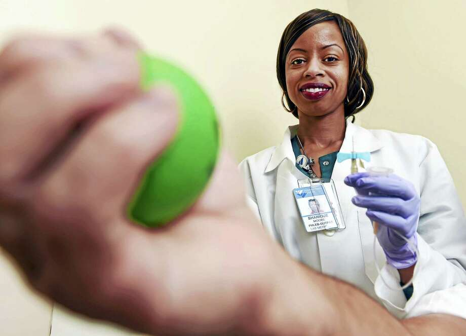Shanique Moore, who became a certified phlebotomist at the Smilow Cancer Center at Yale-New Haven Hospital with the help of ConnCAT. Photo: Peter Hvizdak — New Haven Register   / ©2016 Peter Hvizdak