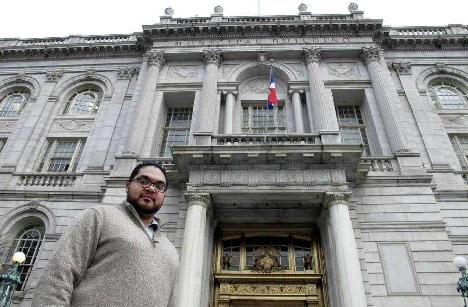 Juan Hernandez, an aide to a Hartford City Council member, poses outside Hartford City Hall on March 7, 2016, in Hartford. Hernandez, 25, is among millennials nationwide with student debt who are worried about being able to qualify for a loan and come up with a down payment for a home. Connecticut and some other states are considering proposals to keep educated, young professionals within their borders for years to come by helping them with their housing costs. Photo: AP Photo/Dave Collins   / Copyright 2016 The Associated Press. All rights reserved. This material may not be published, broadcast, rewritten or redistributed without permission.